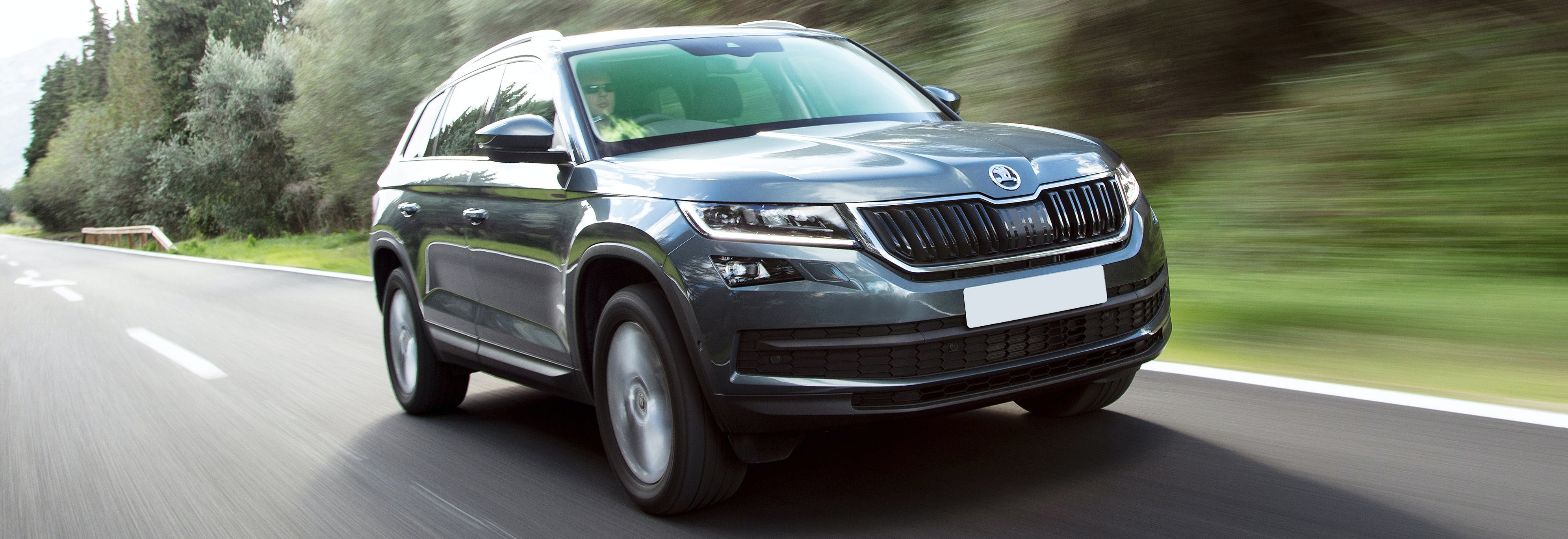 Grey Skoda Kodiaq driving, viewed from the front