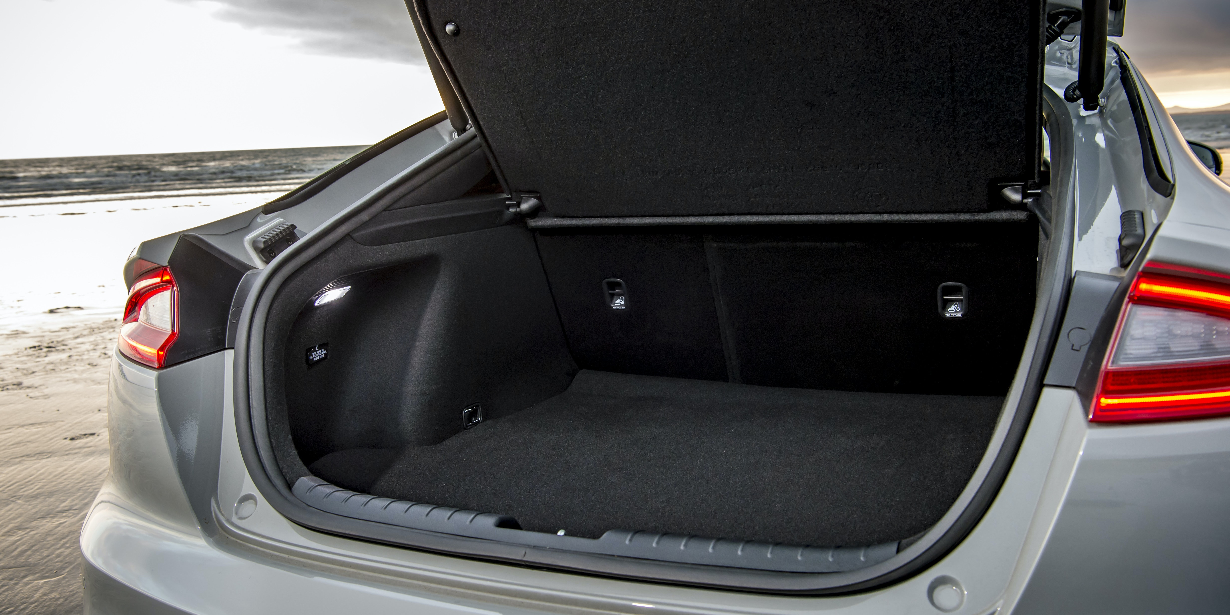 You can fit a bag of golf clubs in the Stinger's boot, but there's more room in alternative models from Audi and BMW