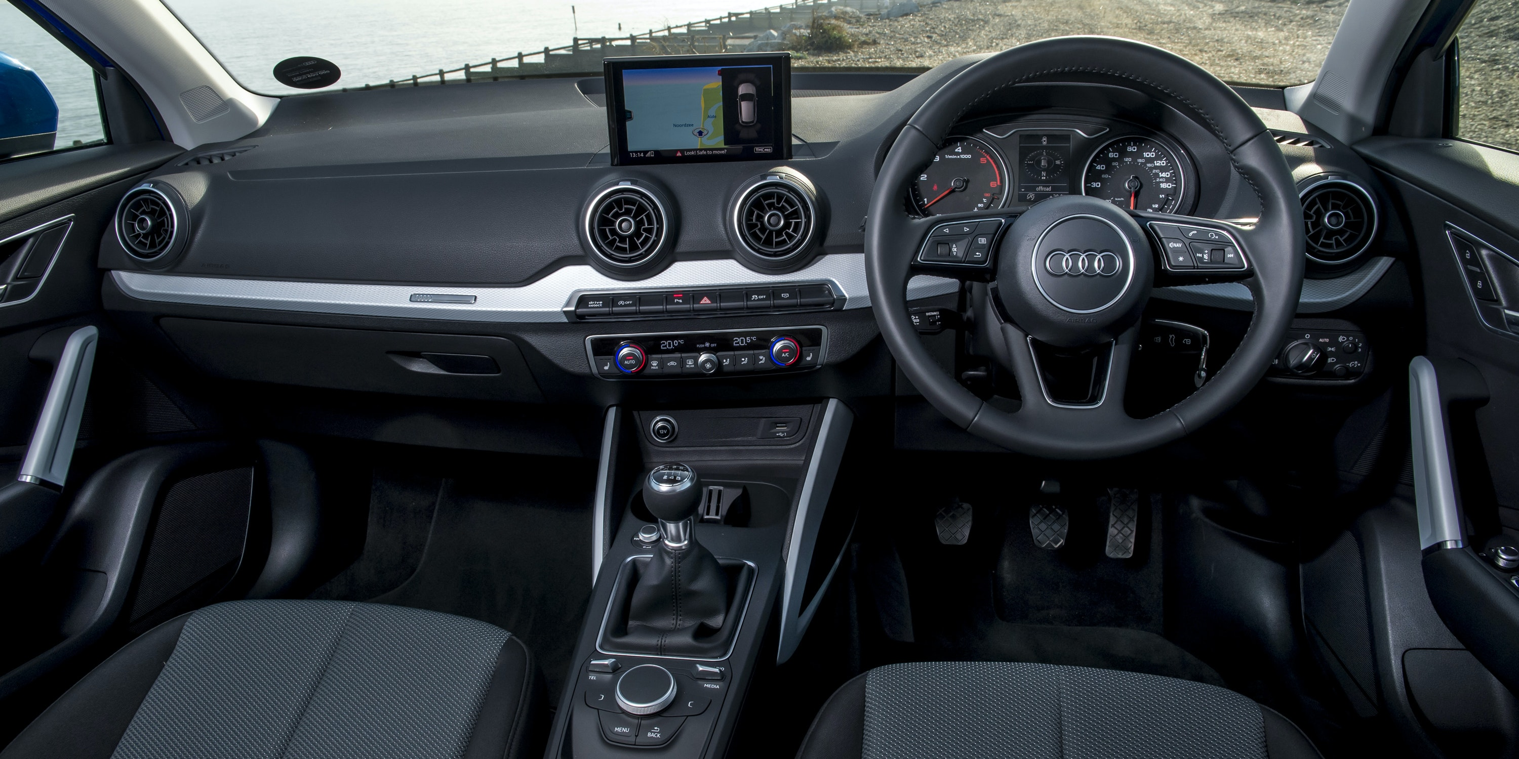 The Q2's minimalist interior is well built and plush