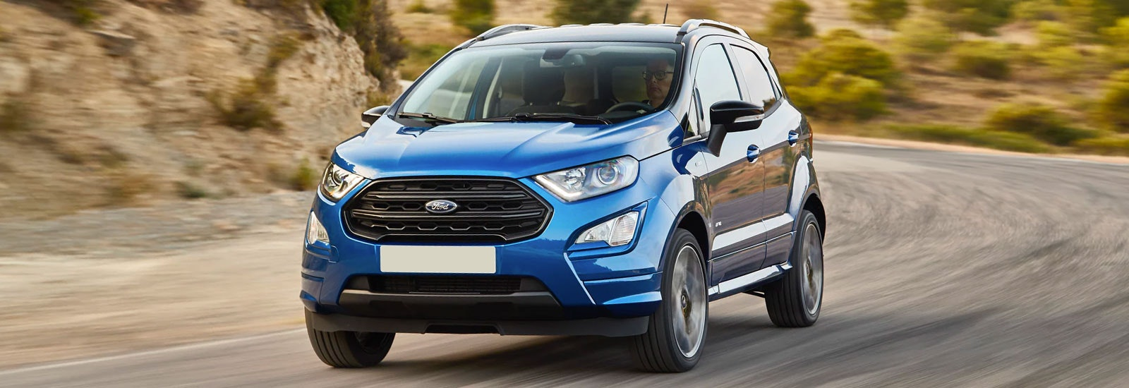 Blue Ford Ecosport driving, viewed from the front