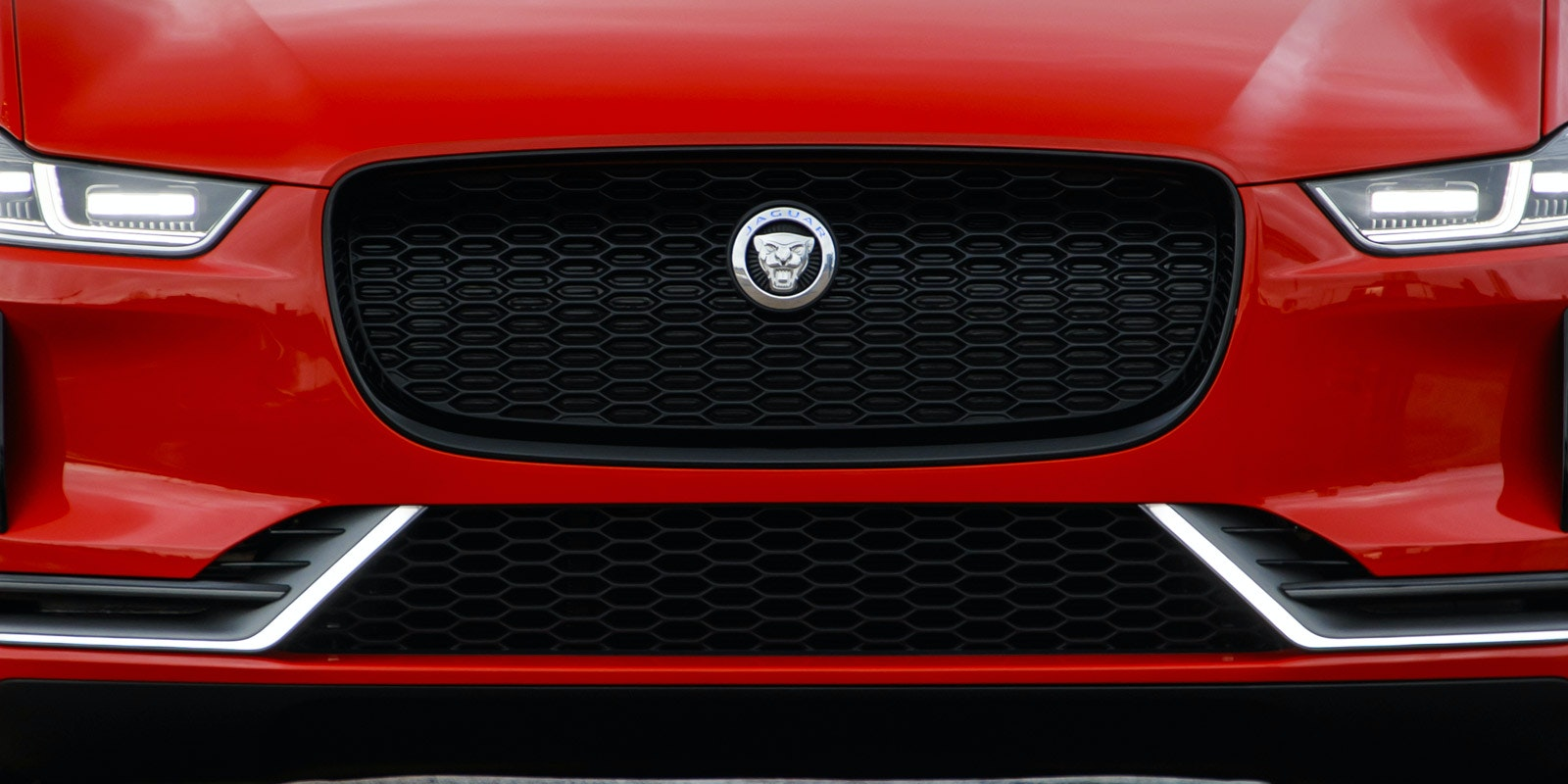 Jaguar i pace red front parked grille close up lead 1.jpg?ixlib=rb 1.1