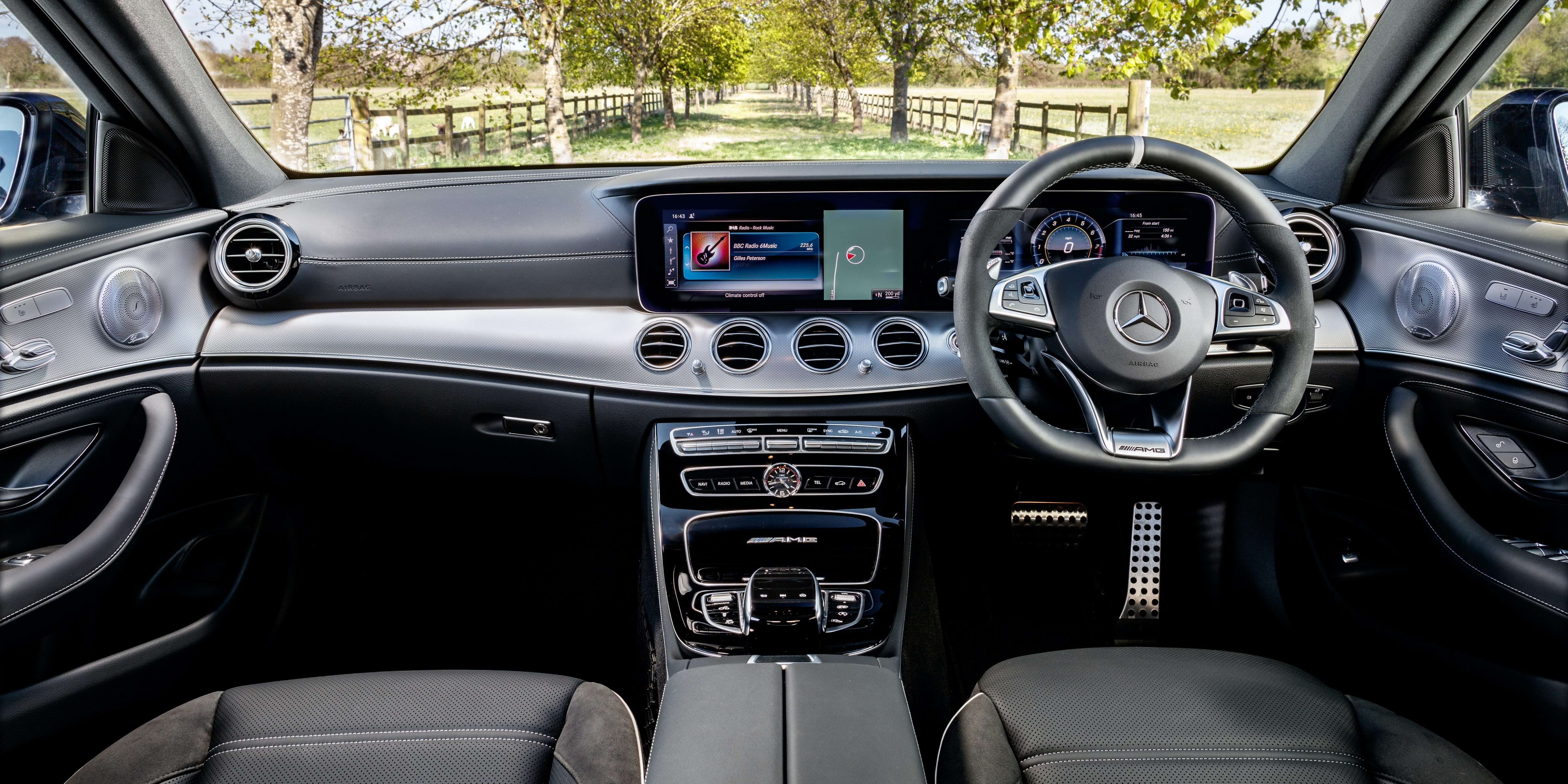 The E63 takes the E-Class's luxurious dash to the next level with some sporty touches, such as the flat-bottomed steering wheel