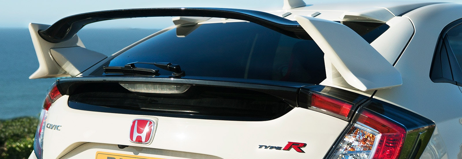 Championship White Honda Civic Type R rear spoiler closeup, viewed from behind