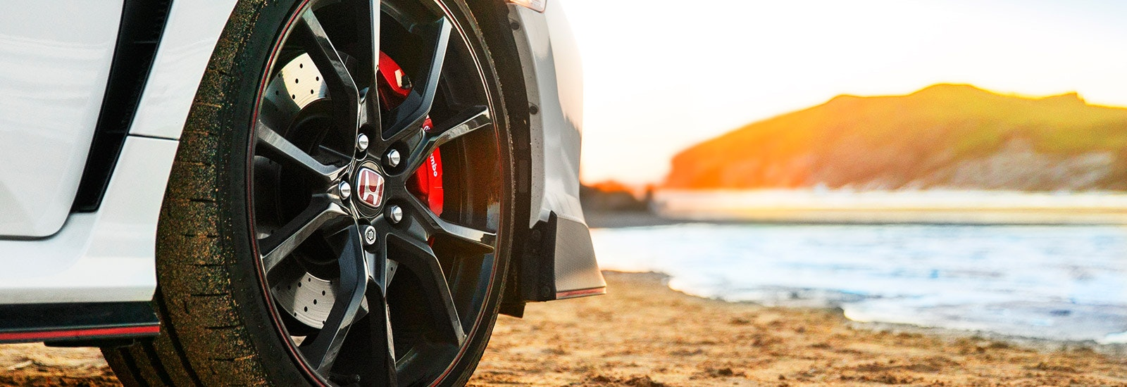 Championship White Honda Civic Type R front wheel closeup, viewed from the front